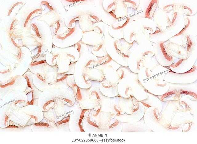 Background of chopped fresh uncooked button mushrooms into thin slices