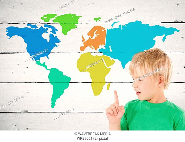 Boy pointing at Colorful Map with paint splatters on wood background