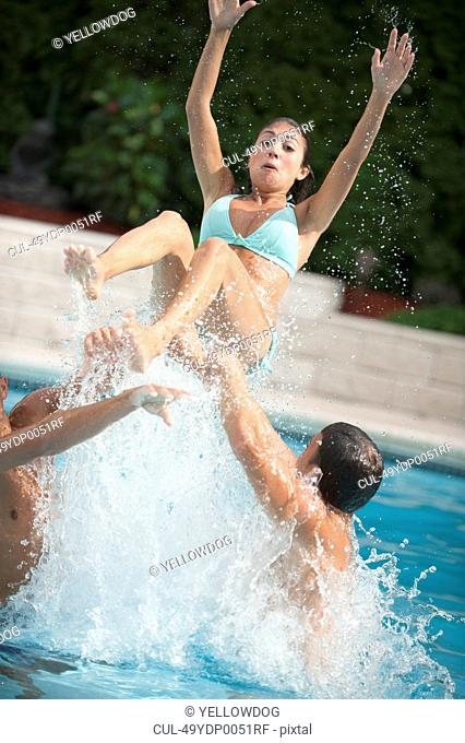 Family splashing in swimming pool