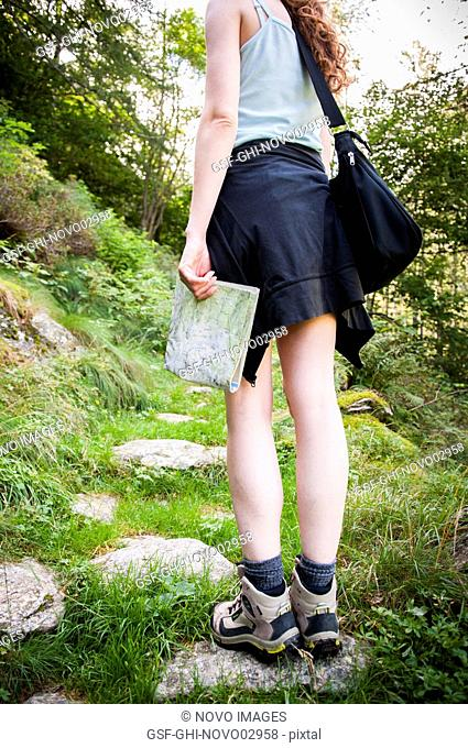 Woman Hiking with Map in Hand