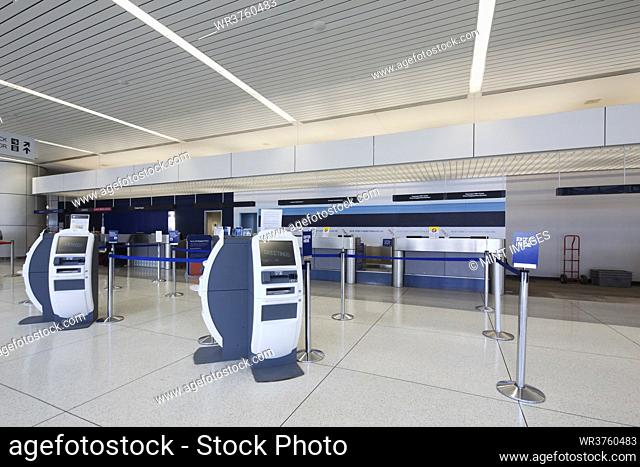 Self check-in desks and traditional baggage check in desks in an empty airport