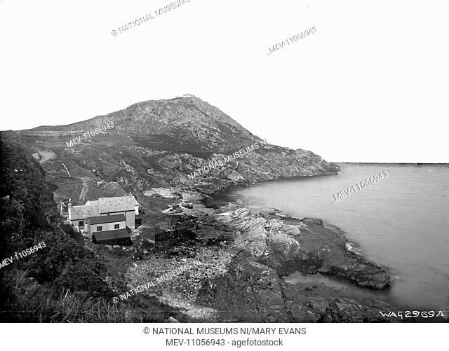 Torr Head and Portaleen Bay, Co. Antrim - a view of Torr Head in the distance and a bay in the foreground with buildings to the left