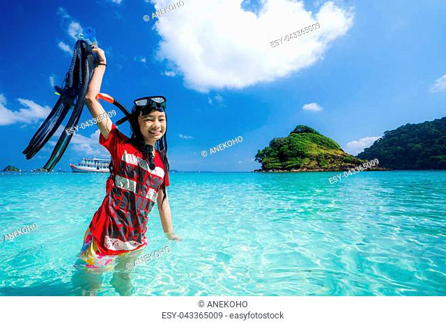 Asian girl travel Thailand sea in Phuket . Child play water, swim and diving