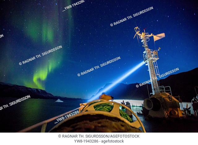 Aurora Borealis seen from a cruise ship, Scoresbysund, Greenland. The Akademik Sergey Vavilov-Russian research vessel built in 1988 currently used as a cruise...
