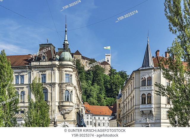 View from the old town through the alley Stritarjeva ulica to the Ljubljana Castle. The Ljubljana Castle is a powerful medieval fortress and the symbol of the...
