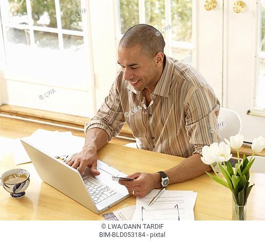 African man shopping online