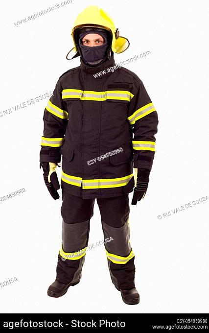 Serious firefighter posing with arms crossed. Full length studio shot isolated on white