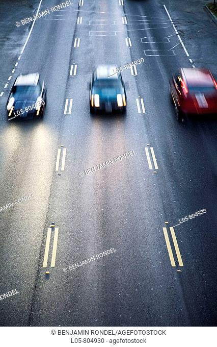 Three cars on a bridge