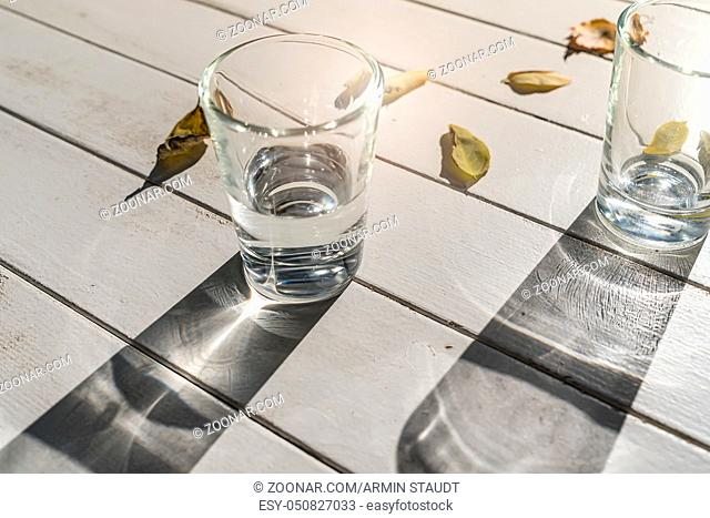two water glasses on a white table