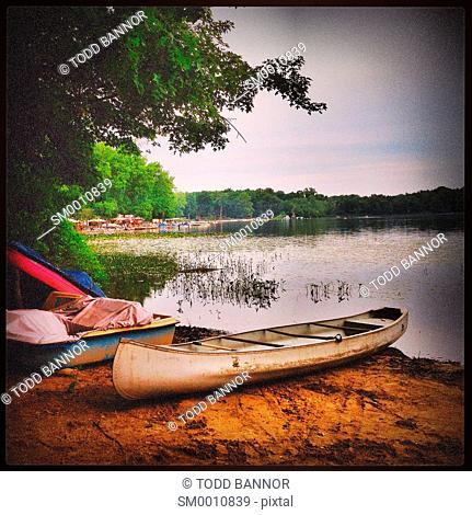 Canoe on beach. Clear Lake, Michigan, USA