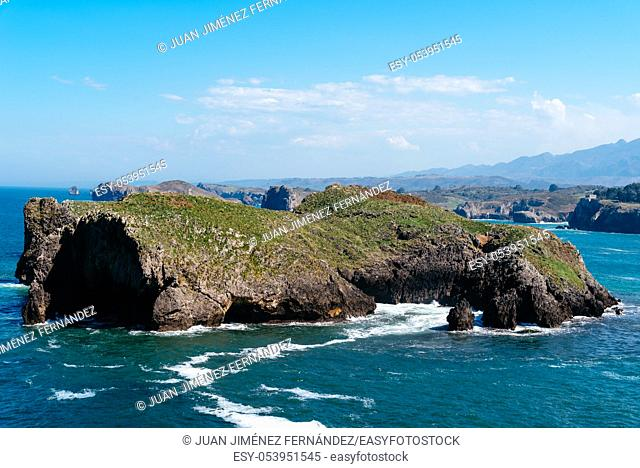 Scenic view of sea against blue sky in rocky coast. Borizo Beach, Llanes, Asturias, Spain