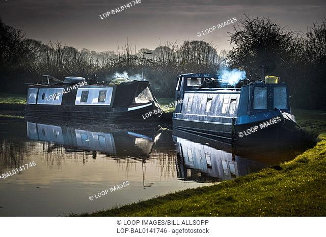 Two narrowboat homes at moorings on a canal
