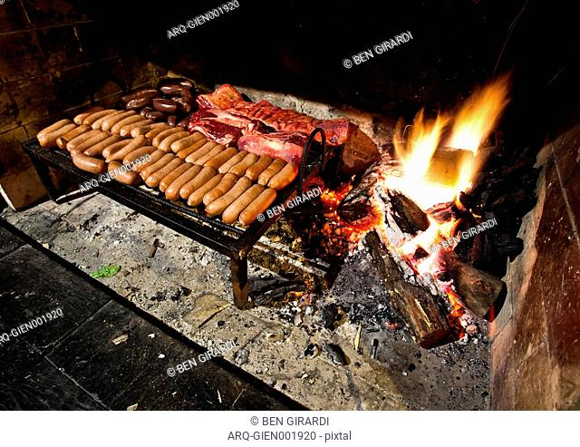 A Grill Loaded With A Variety Of Meat