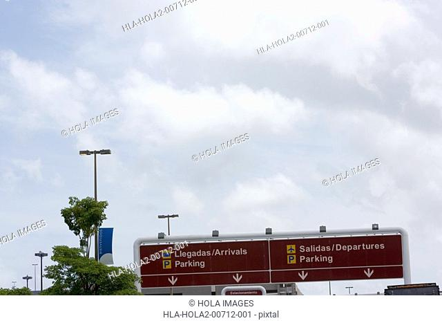 Arrival and Departure airport sign, bilingual