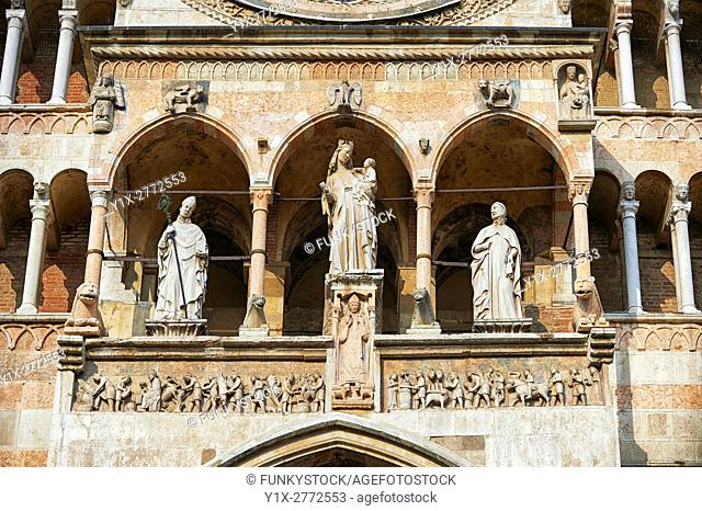 Statue of the Madonna with Child on the facade of the Romanesque Cathedral of Cremona, begun 1107, with later Gothic, Renaissance & Baroque elements, Cremona