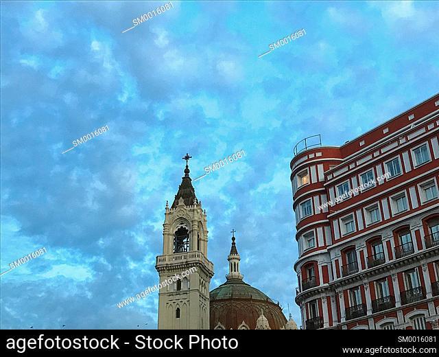 San Manuel y San Benito church and house at dawn. Alcala street, Madrid, Spain