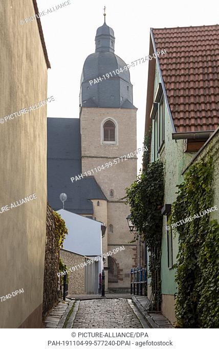 24 October 2019, Eisleben: 23.10.2019, Saxony-Anhalt, Eisleben: View of the baptistery of Martin Luther, St. Petri-St.Pauli