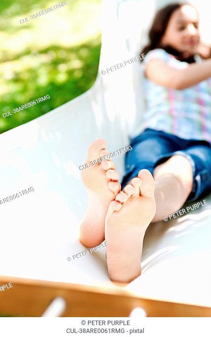 Close up of girls feet outdoors