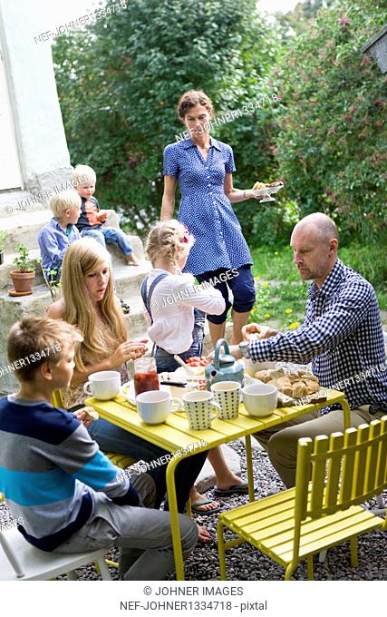 Family having lunch in back yard
