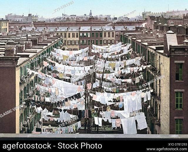 A Monday Washing, New York City, USA. After a photo-chromolithograph by an unidentified photographer, published circa 1900 by the Detroit Photographic Co