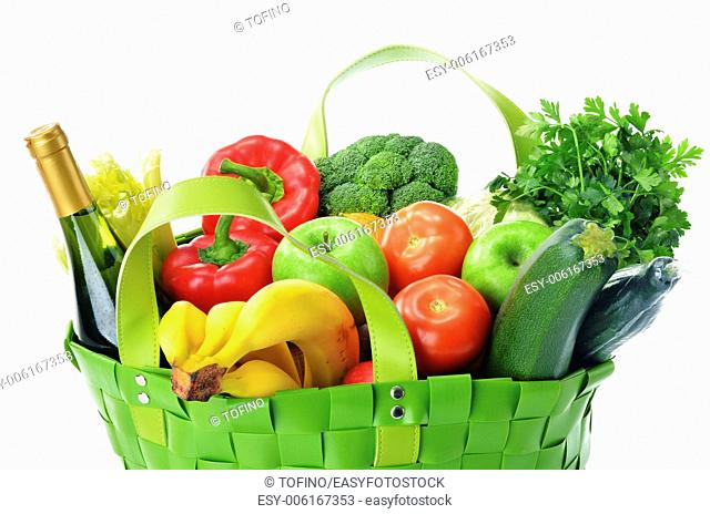 Green shopping bag with groceries isolated on white background