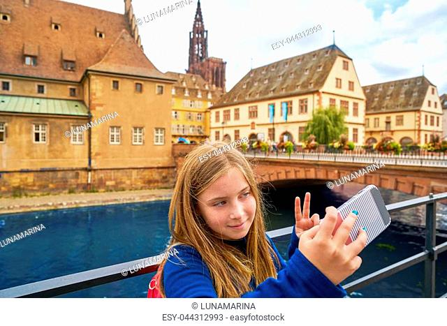 Strasbourg city kid girl selfie tourist photo in Alsace France
