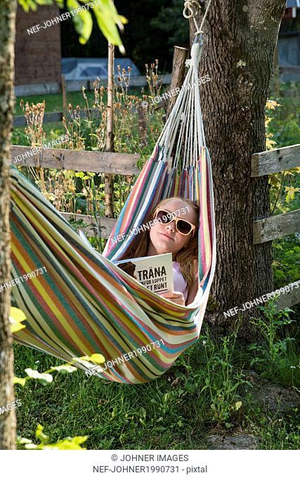 Teenage girl resting in hammock