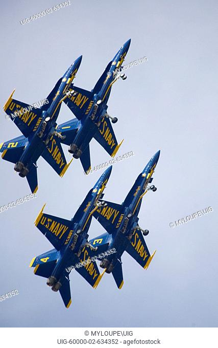 Suitland, Maryland: May 17, 2008. The elite U.S. Navy Blue Angels speed in formation at hundreds of miles per hour at the 2008 Joint Service Open House air show...