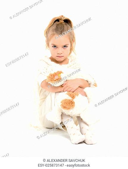 Little Girl in a White Dress Posing, on white background