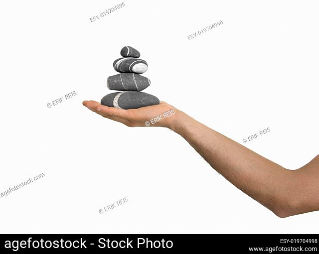 Balanced stones on a man Hand