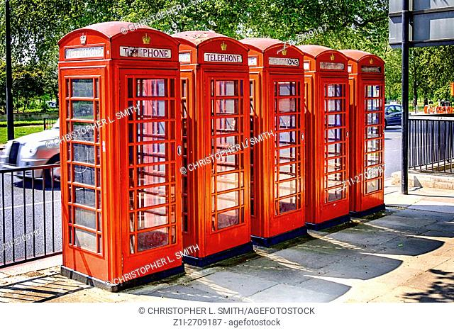 Group of five red telelphone boxes in London