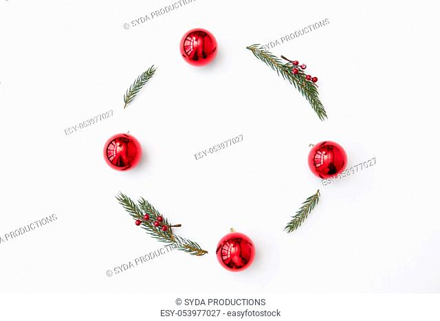 christmas frame of fir branches with red balls