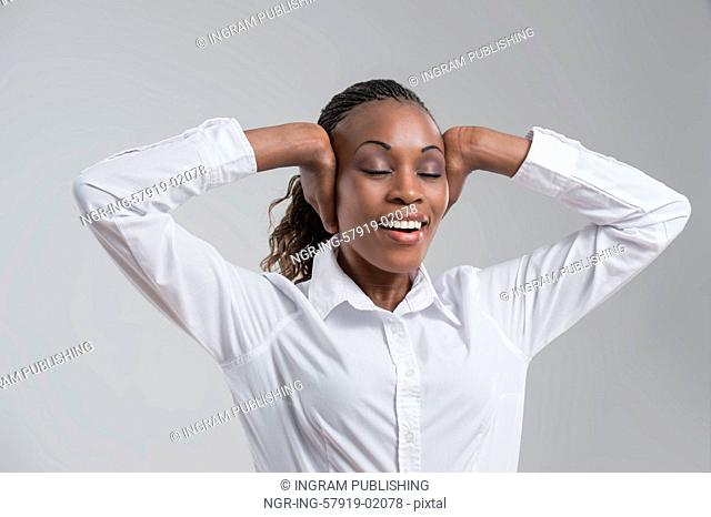 African business woman stretching and relaxing after long working hours, closing her ears