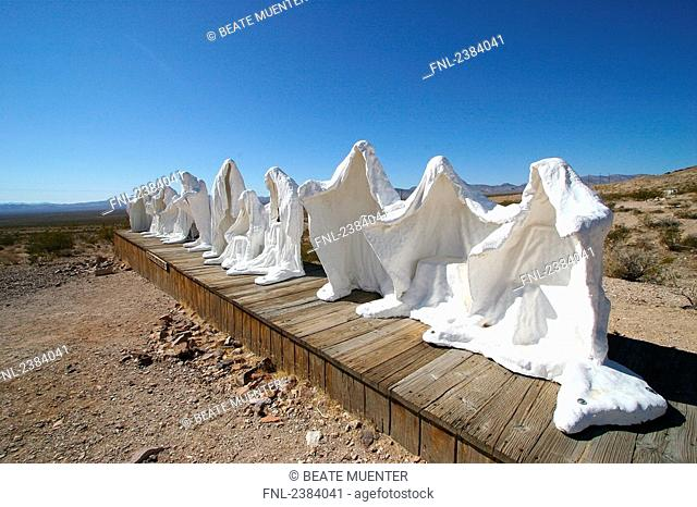Sculptures of ghost on landscape, Goldwell Open Air Museum, Rhyolite, Nevada, USA