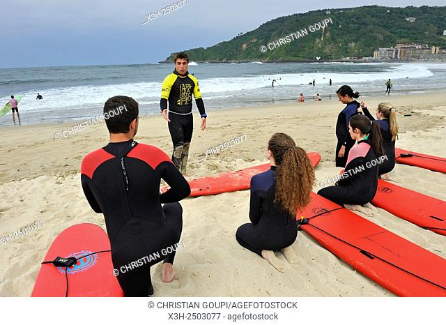 surf class on Zurriola beach, district of Gros, San Sebastian, Bay of Biscay, province of Gipuzkoa, Basque Country, Spain, Europe