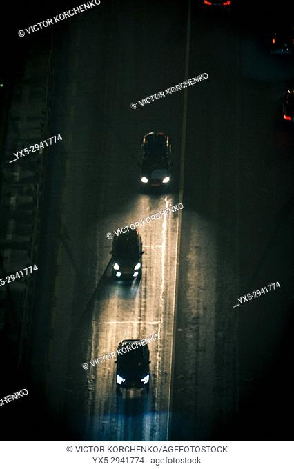 Road with cars moving at night