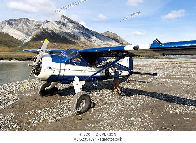 Bushplane arriving at the Noatak River for a river rafting trip, Brooks Range, Arctic Alaska; Alaska, United States of America