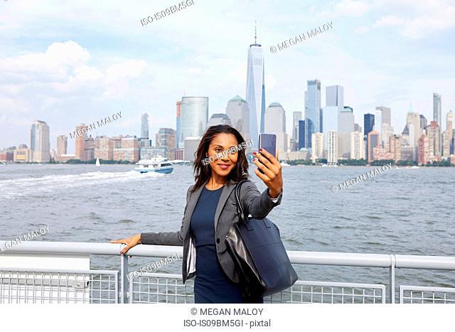 Businesswoman taking selfie, New York, US