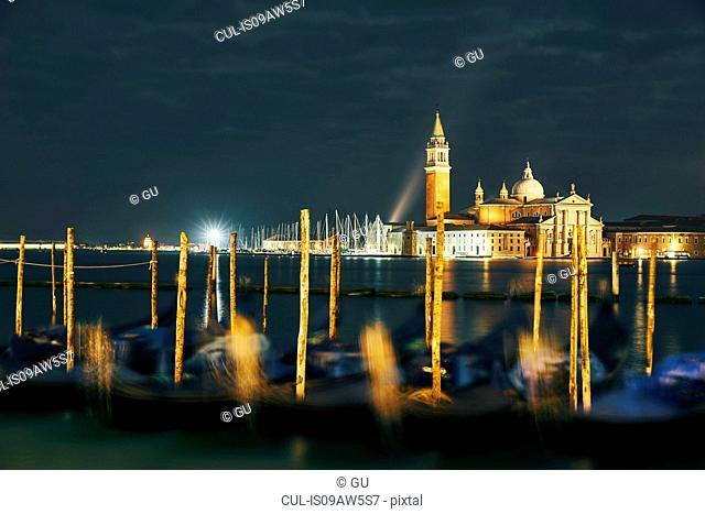 Blurred gondolas in front of Church of San Giorgio Maggiore at night, Venice, Italy