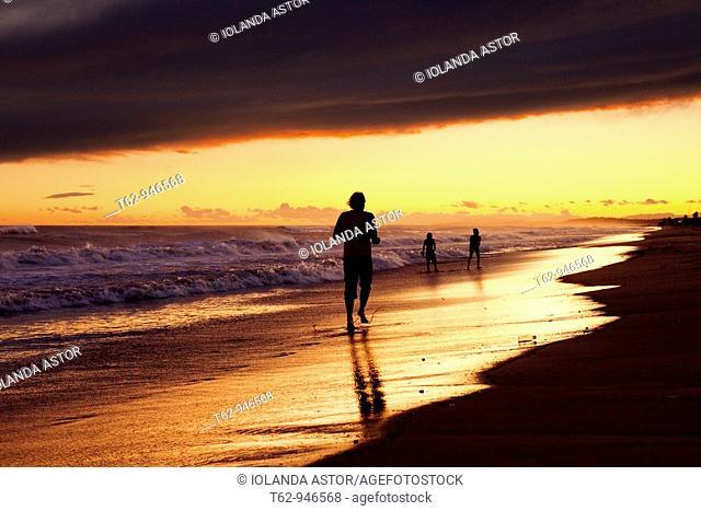 Sunset on the beach and distant figures  Color  Costa Dorada, Spain