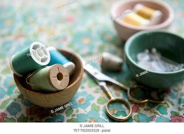 Spools of thread in bowl