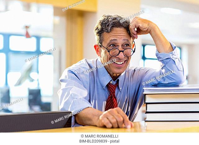 Senior man smiling in library
