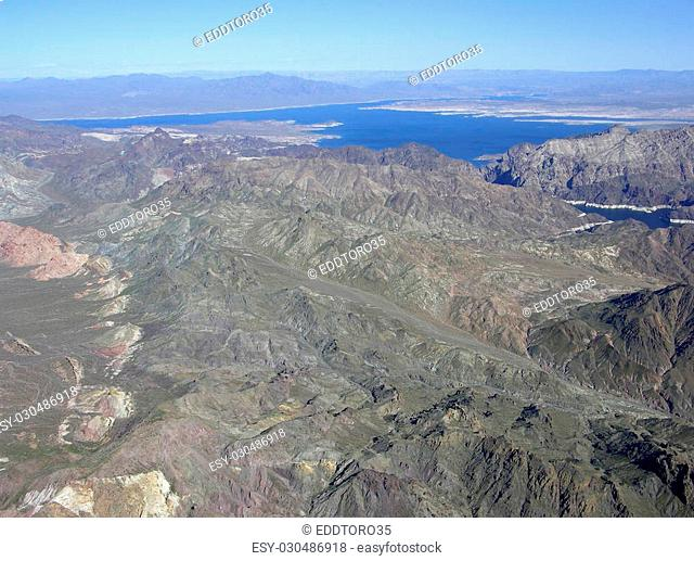 Aerial view of mountains around Lake Mead which is located in the state of Nevada. Formed by water impounded by the Hoover Dam in the USA