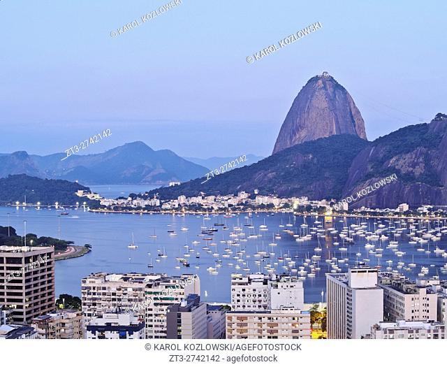 Brazil, City of Rio de Janeiro, Twilight view over Botafogo Neighbourhood towards the Sugarloaf Mountain