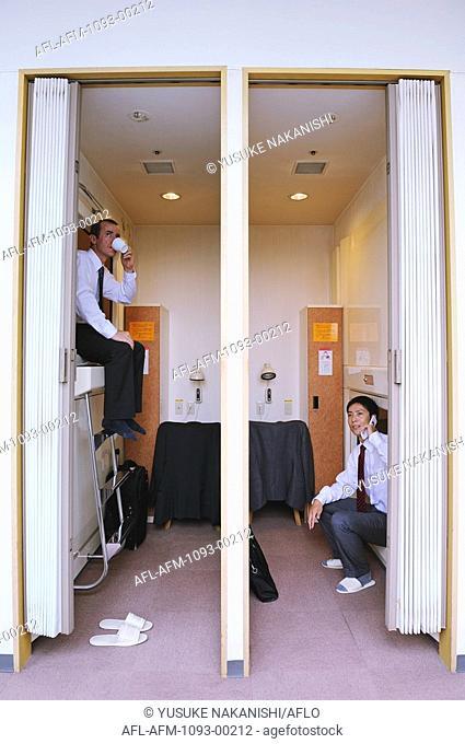 Businessmen sitting in hotel