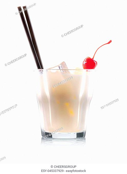 White russian or pina colada cocktail in old fashioned glass with black straw and cherry isolated on white background. Clipping path