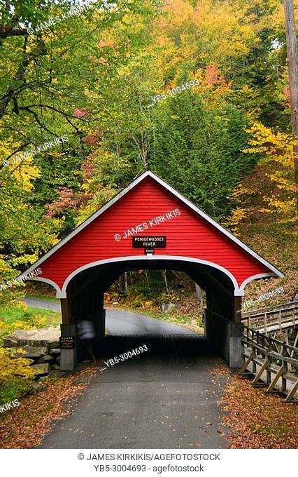A quaint covered bridge crosses over the Pemigewasset River at Franconia State Park, New Hampshire