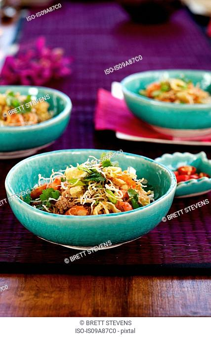 Crispy noodle prawn salad with spring onions, coriander and chilli