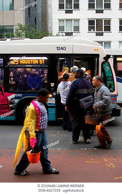 NEW YORK, NY, USA - OCTOBER 31, 2012: Bus Service having resumed after Hurricane Sandy hit the city, MTA busses remain rare and overcrowded in blacked-out Lower...