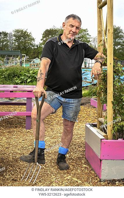 Jim Marshall, a nurse, working on, plot 65, Eglinton Growers Allotments, Kilwinning, Ayrshire, Scotland, UK